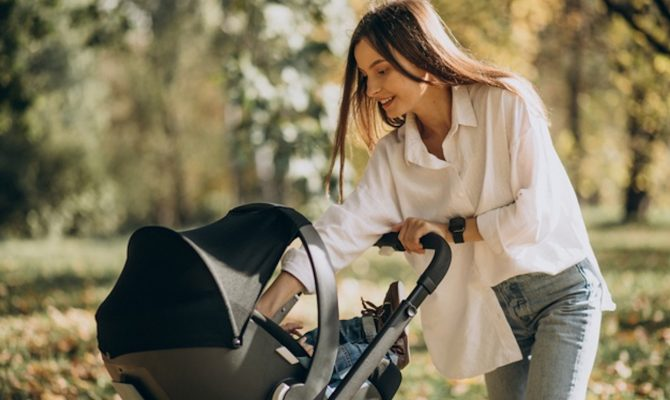 young-mother-walking-with-baby-stroller_1303-25360